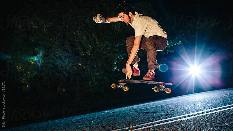 downhill skater gets some air by Brian Powell for Stocksy United