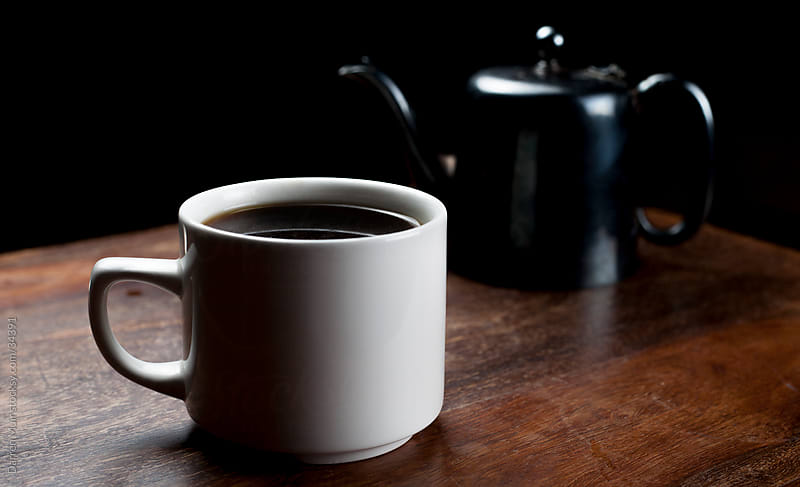 Black coffee in a white cup. by Darren Muir for Stocksy United