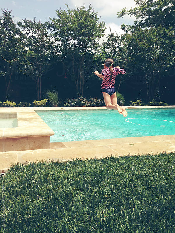 Young Girl Jumps into A Backyard Pool by Leigh Love for Stocksy United