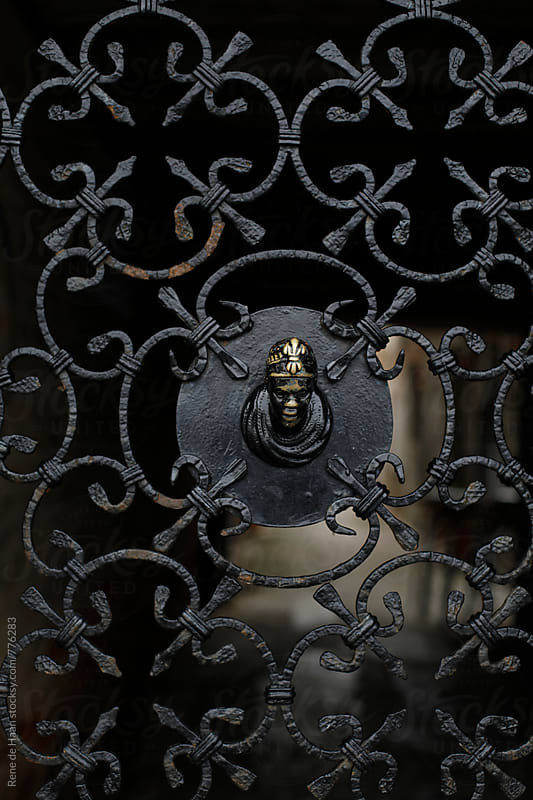 gate of wrought iron by Rene de Haan for Stocksy United