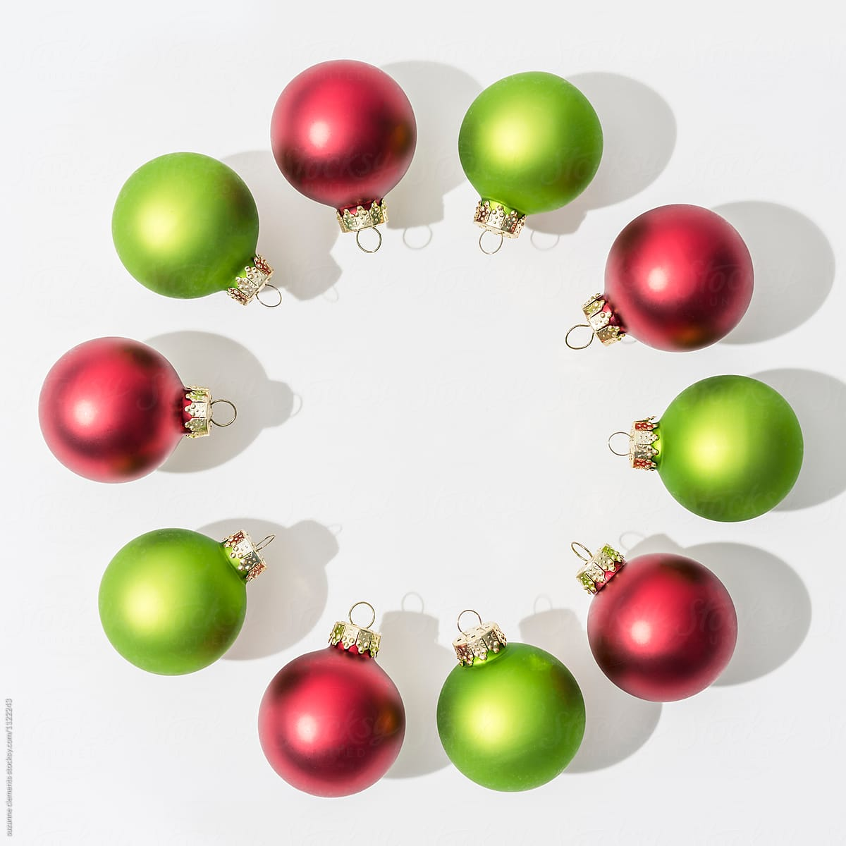 festive red and green glass christmas ornaments by suzanne clements for stocksy united - Glass Christmas Ornaments