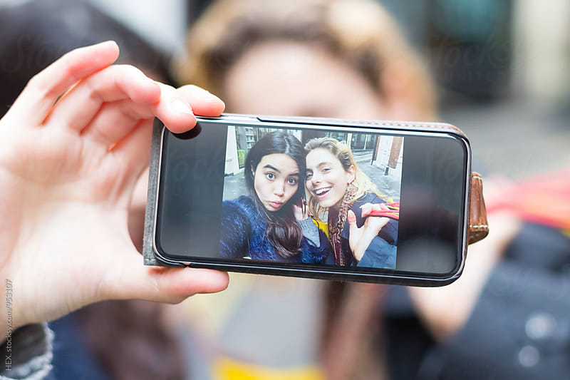 Female Best Friends Taking a Picture with the Phone by HEX. for Stocksy United