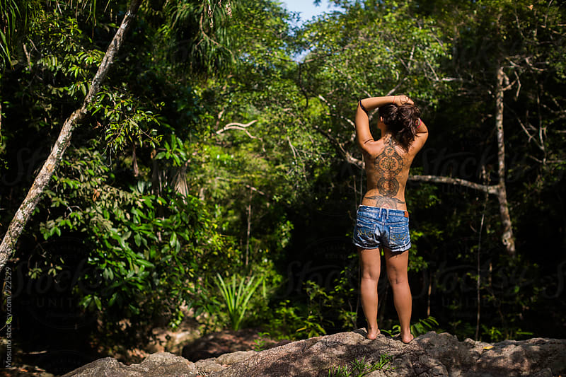 Tattooed Topless Woman in the Jungle by Mosuno for Stocksy United
