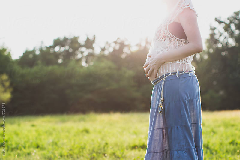 Belly of pregnant woman in the nature by michela ravasio for Stocksy United