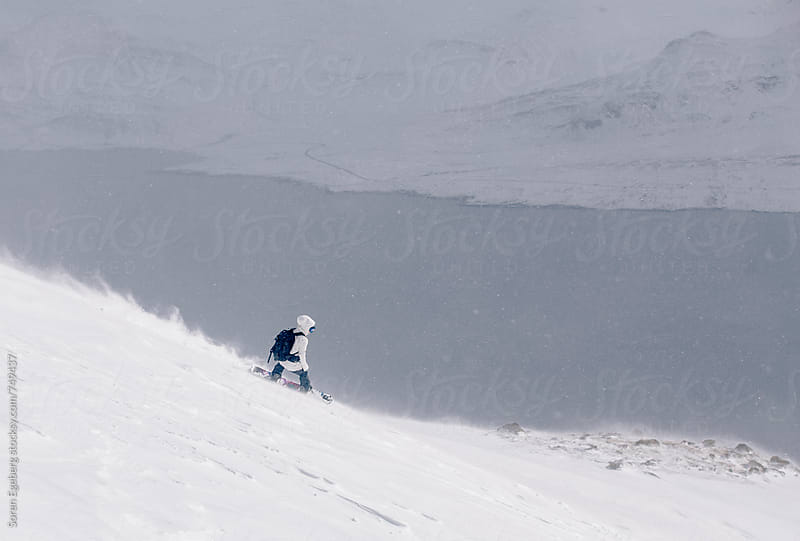 Bad weather skiing in snow storm by Søren Egeberg Photography for Stocksy United