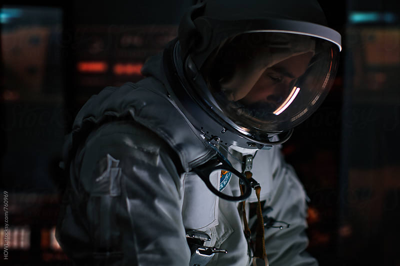 An Astronaut working inside his space shuttle  by HOWL for Stocksy United