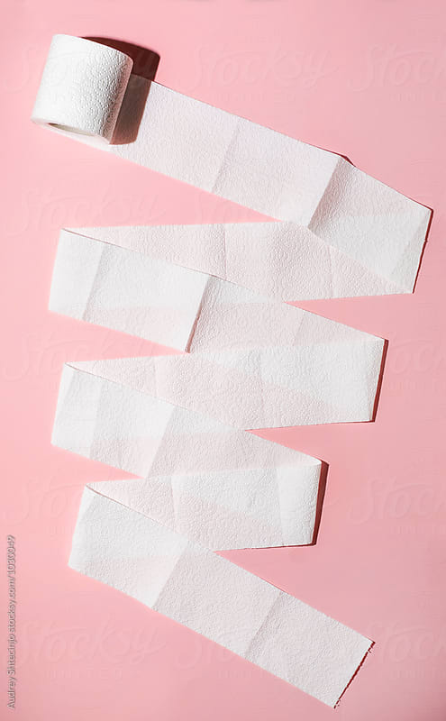 Toilet paper rolls on pink background. by Audrey Shtecinjo for Stocksy United