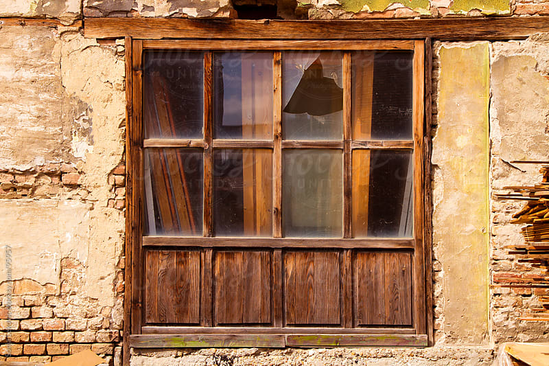old broken brown window by Sonja Lekovic for Stocksy United