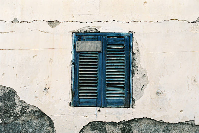 Blue shuttered window in Santorini, Greece by Kirstin Mckee for Stocksy United