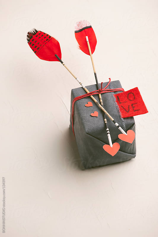 Hipster gift with two arrows and red hearts. Valentine's day. by BONNINSTUDIO for Stocksy United