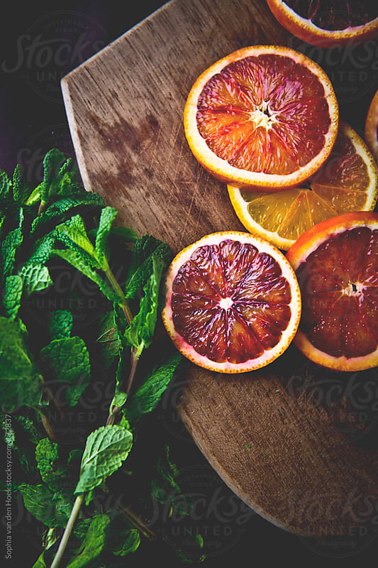 Blood orange and mint by Sophia van den Hoek for Stocksy United