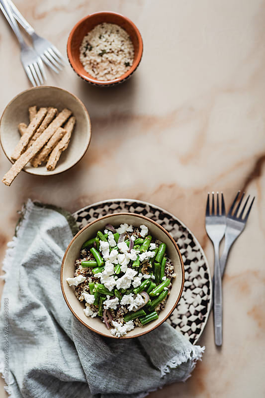 Quinoa with green beans and feta cheese by Tatjana Ristanic for Stocksy United