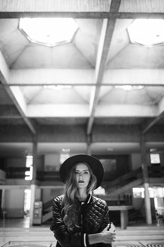 Trendy young woman wearing hat by Ani Dimi for Stocksy United