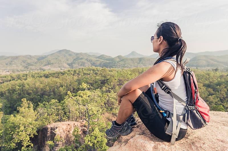 Female hiker enjoying view over mountainous landscape by Soren Egeberg for Stocksy United