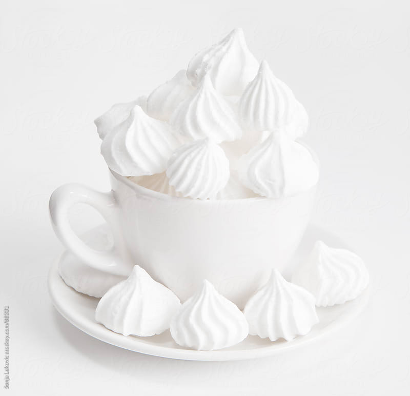 white sugar candy meringue in a white cup by Sonja Lekovic for Stocksy United