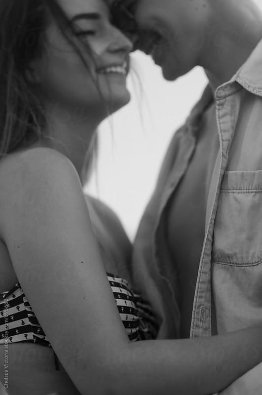 A black and white portrait of a young couple by Chelsea Victoria for Stocksy United