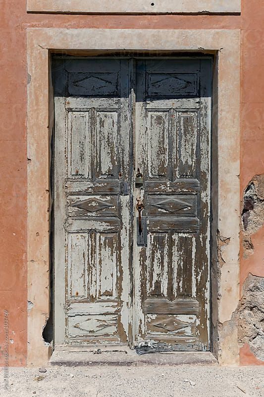 Old door with paint peeling, Santorini, Greece by Paul Phillips for Stocksy United