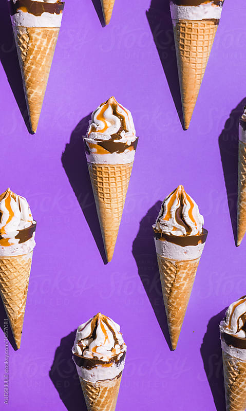 Ice creams with caramel in cone arranged on purple background. by Audrey Shtecinjo for Stocksy United