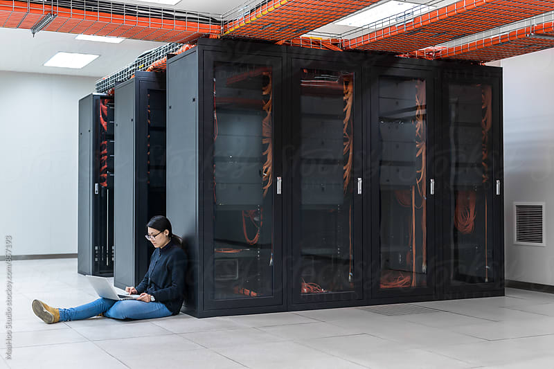 Female technician working in data center by MaaHoo Studio for Stocksy United