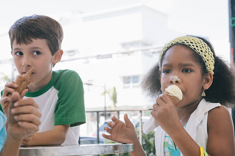 School Children Enjoying Ice Cream on a Hot Day in Miami by Joselito Briones for Stocksy United