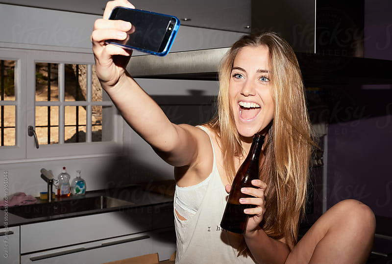 Beautiful long-haired woman taking selfie by Guille Faingold for Stocksy United