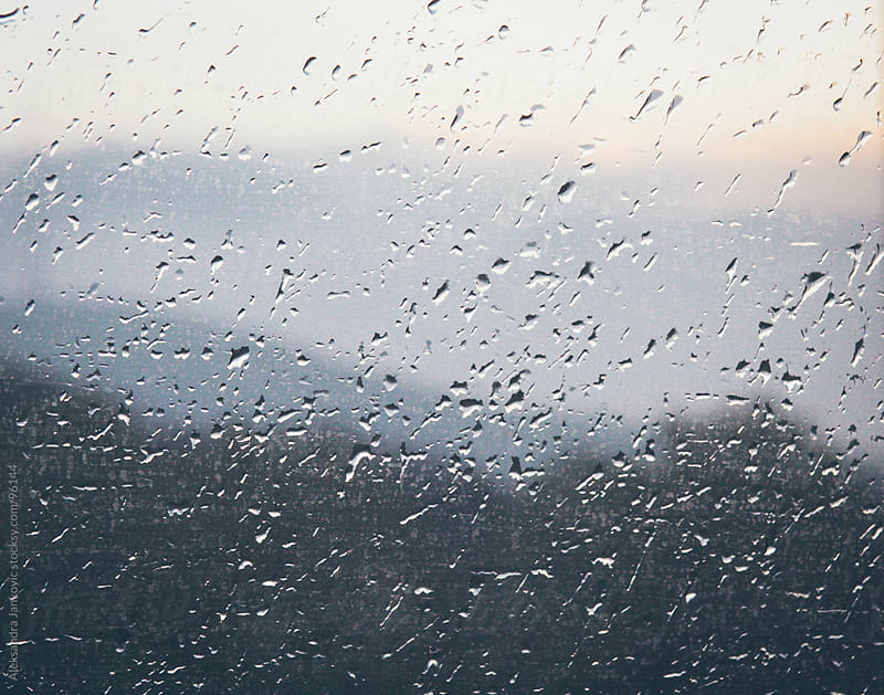 Raindrops on the window glass by Aleksandra Jankovic for Stocksy United