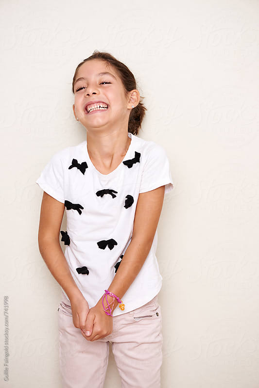 smiling little brunette girl by Guille Faingold for Stocksy United