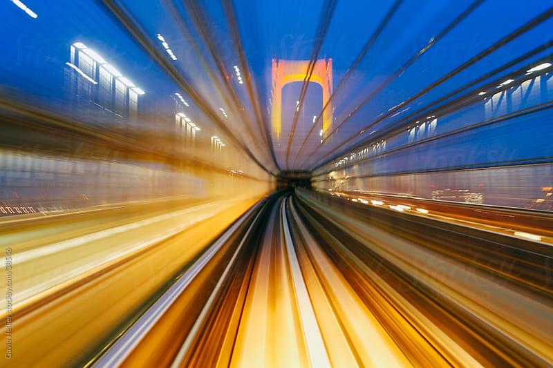 Asia, Japan, Honshu, Tokyo, POV blurred motion from a moving train crossing the Tokyo Bay Rainbow Bridge by Gavin Hellier for Stocksy United