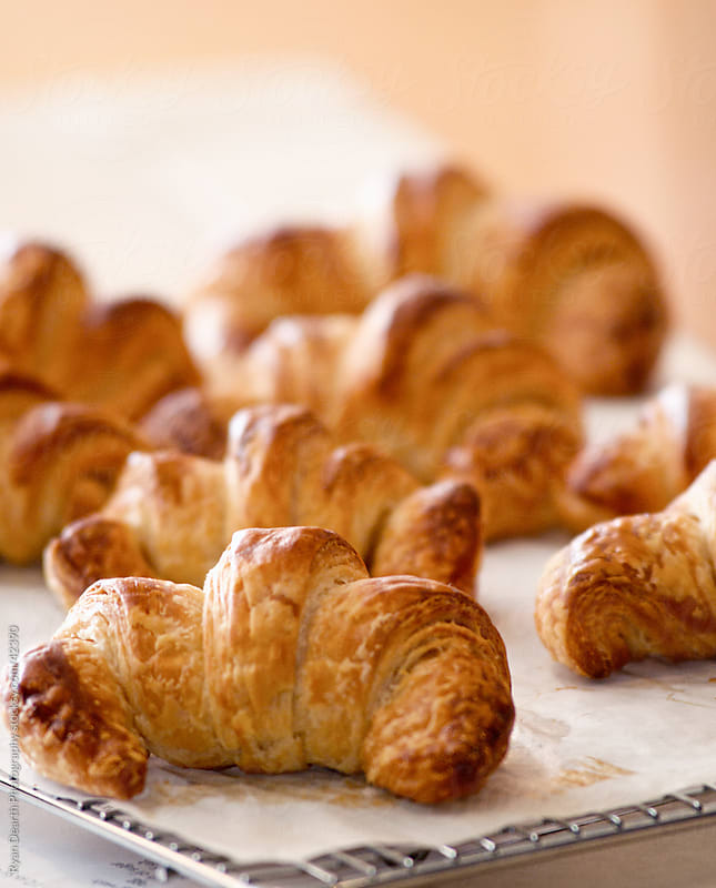 Freshly Baked Croissants on Cooling Rack by Ryan Dearth Photography for Stocksy United