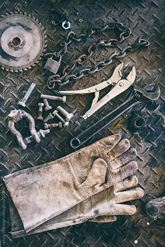 gloves and metal work tools on a surface by Micky Wiswedel for Stocksy United