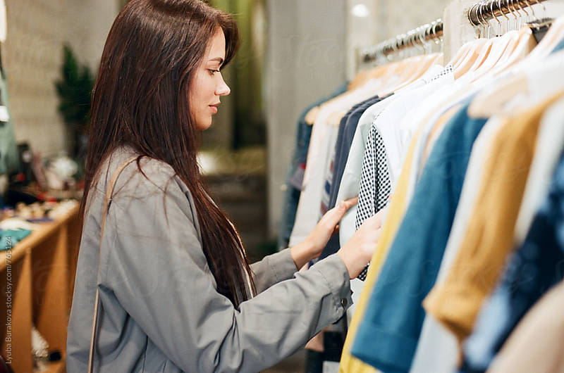 Young woman shopping at a boutique by Liubov Burakova for Stocksy United