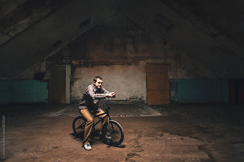 Man Sitting on His BMX Bike by Lumina for Stocksy United