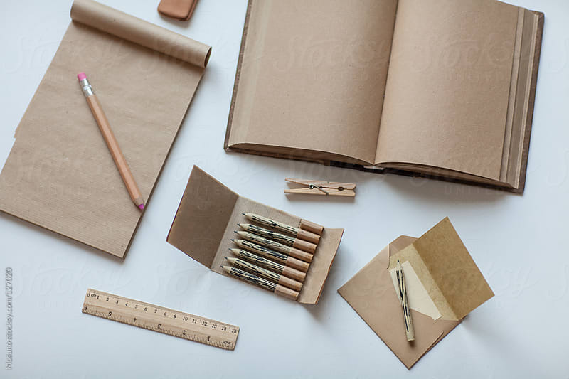 Office supplies on a white table. by Mosuno for Stocksy United