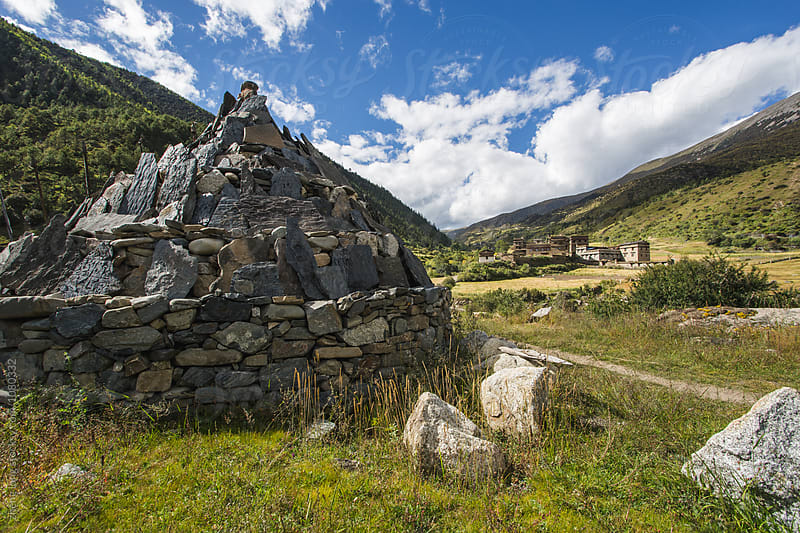 The village and  Marnyi Stone in Tibet by zheng long for Stocksy United