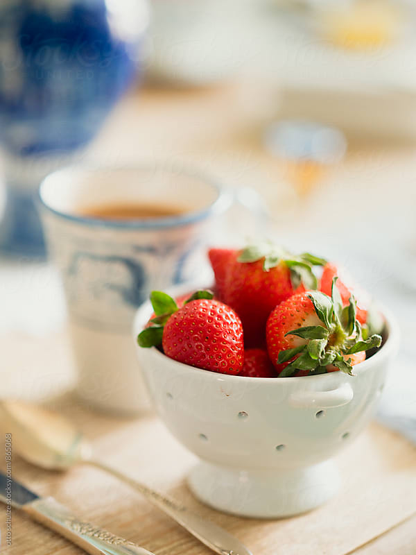 bowl of fresh strawberries by otto schulze for Stocksy United