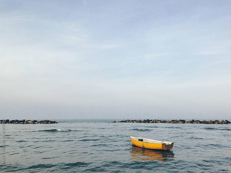Lonely Boat by Tommaso Tuzj for Stocksy United