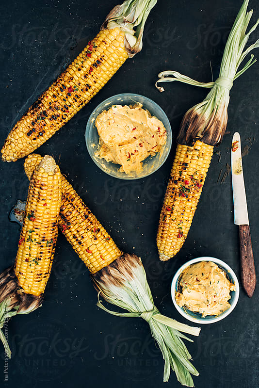 Food: Grilled Corncobs with spicy herbed garlic chili butter by Ina Peters for Stocksy United