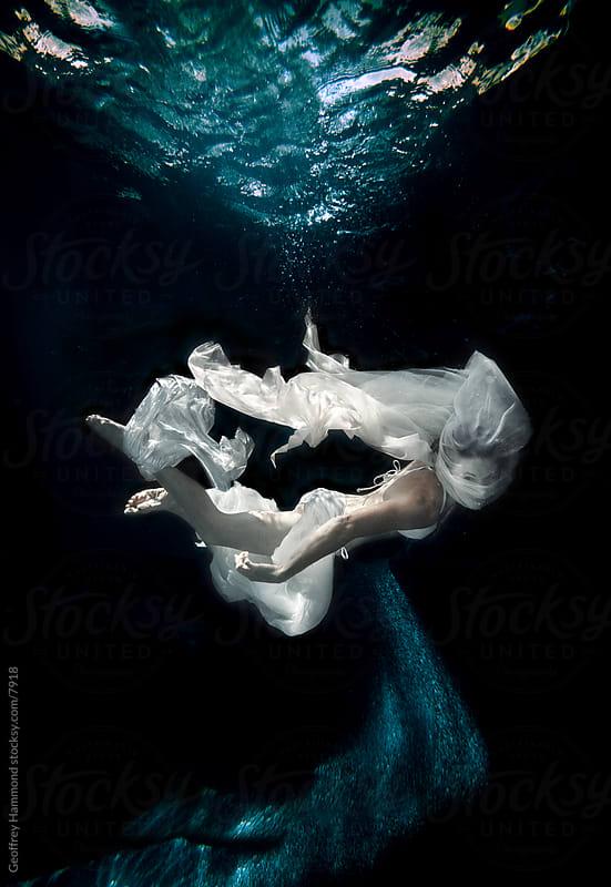 Woman Underwater by Geoffrey Hammond for Stocksy United