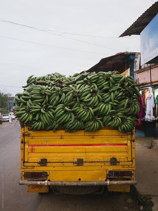 Truck overfull of bananas by Martin Matej for Stocksy United