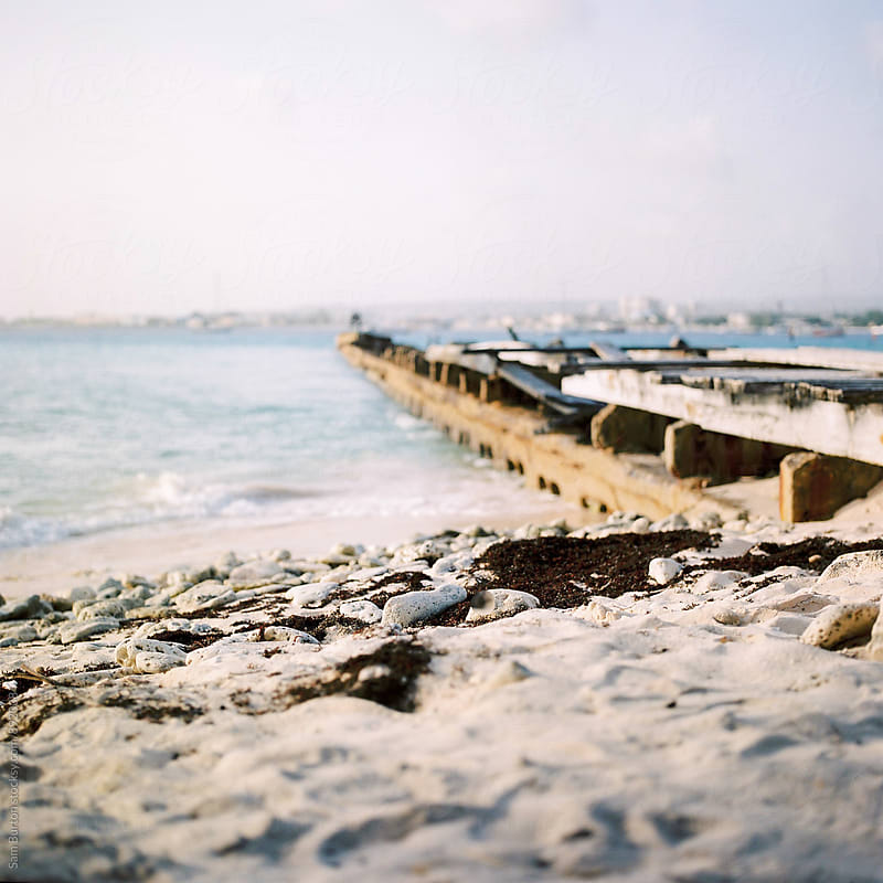 Barbados beach and pier by Sam Burton for Stocksy United