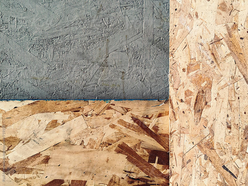 Paint on pieces of plywood of building exterior, close up by Paul Edmondson for Stocksy United