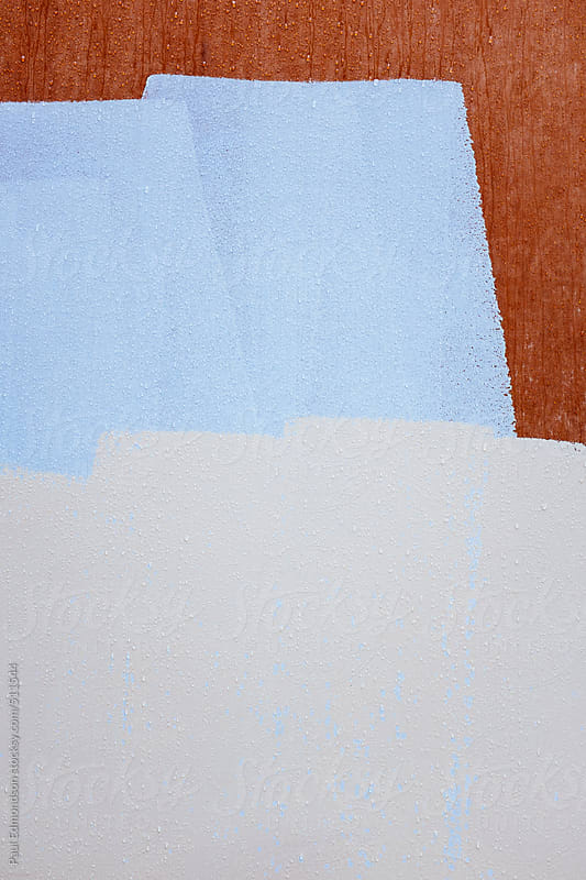 Paint covering graffiti on building wall, close up by Paul Edmondson for Stocksy United