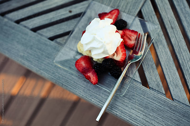 Healthy dessert  of strawberries, pound cake and homemade whipepd creamwith fruit by Carolyn Lagattuta for Stocksy United