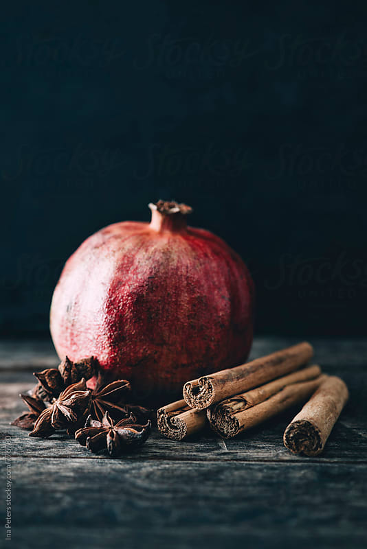 Food: Pomegranate, star anise and cinnamon by Ina Peters for Stocksy United