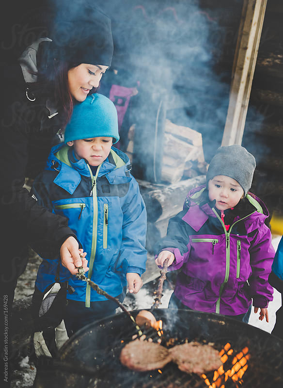 outdoor winter cooking by Andreas Gradin for Stocksy United