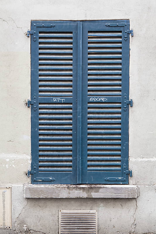 Blue shutters covering a window. by kkgas for Stocksy United