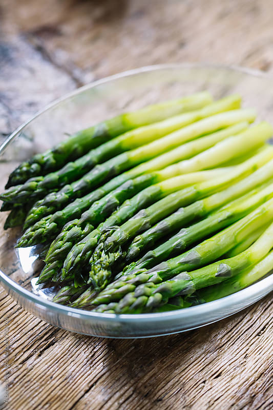 Boiled fresh asparagus by Alberto Bogo for Stocksy United