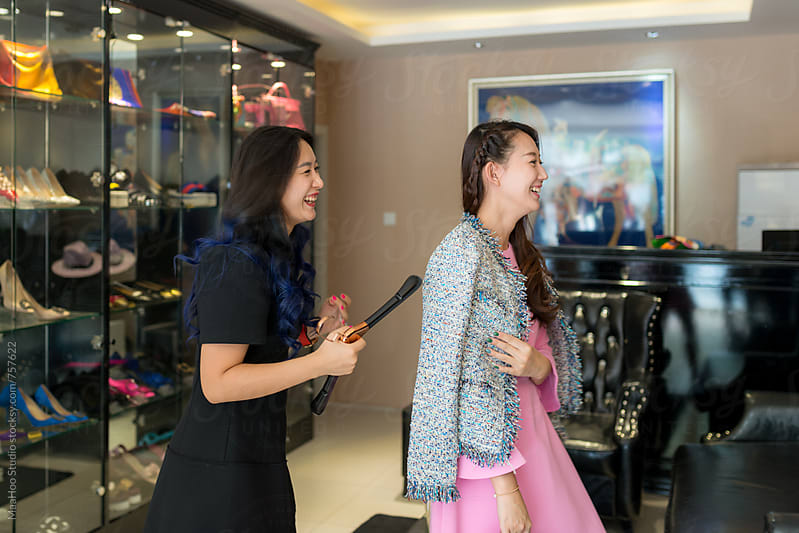 Young business owner helping customer at clothing store by Maa Hoo for Stocksy United