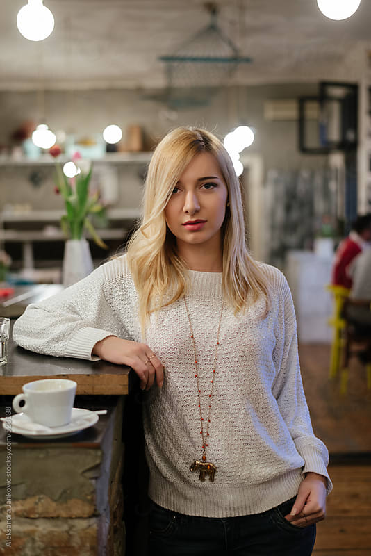 Portrait of a beautiful blond woman at the cafe by Aleksandra Jankovic for Stocksy United