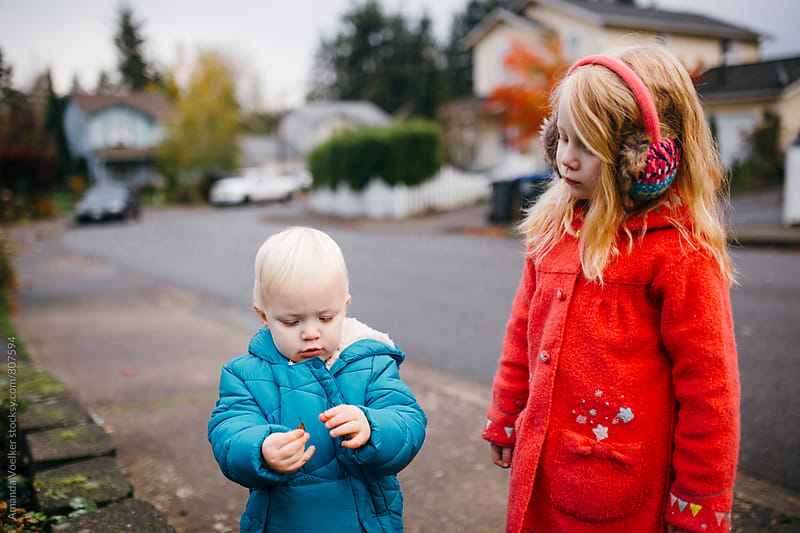 Little Brother and sister stop together on their Walk by Amanda Voelker for Stocksy United